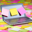Netbook with reminder notes — Stock Photo