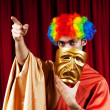 Actor with maks in a funny theater concept — Stock Photo #8114726