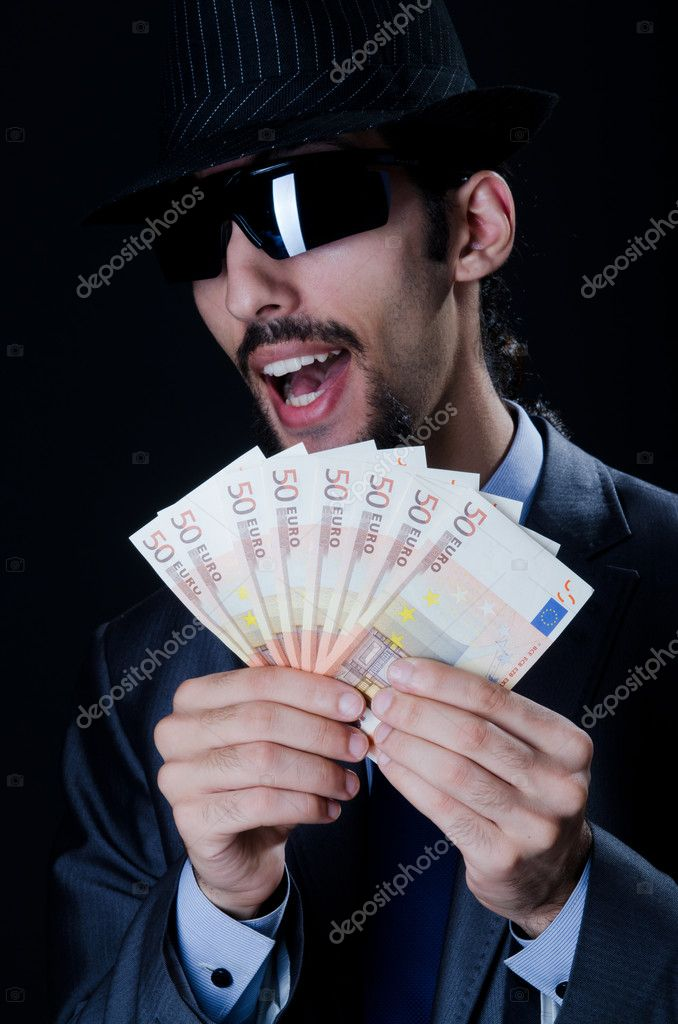 Man with counterfeir money — Stock Photo #8112181
