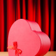 Heart shaped gift box against background - Stockfoto