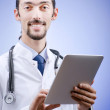 Doctor working on the tablet — Stock Photo #8124498