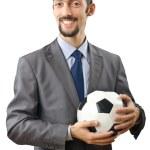 Businessman holding football on white — Stock Photo #8126435