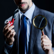 Detective with magnifying glass and pipe — Stock Photo #8745510