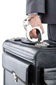 Man with briefcase and handcuffs — Stock Photo