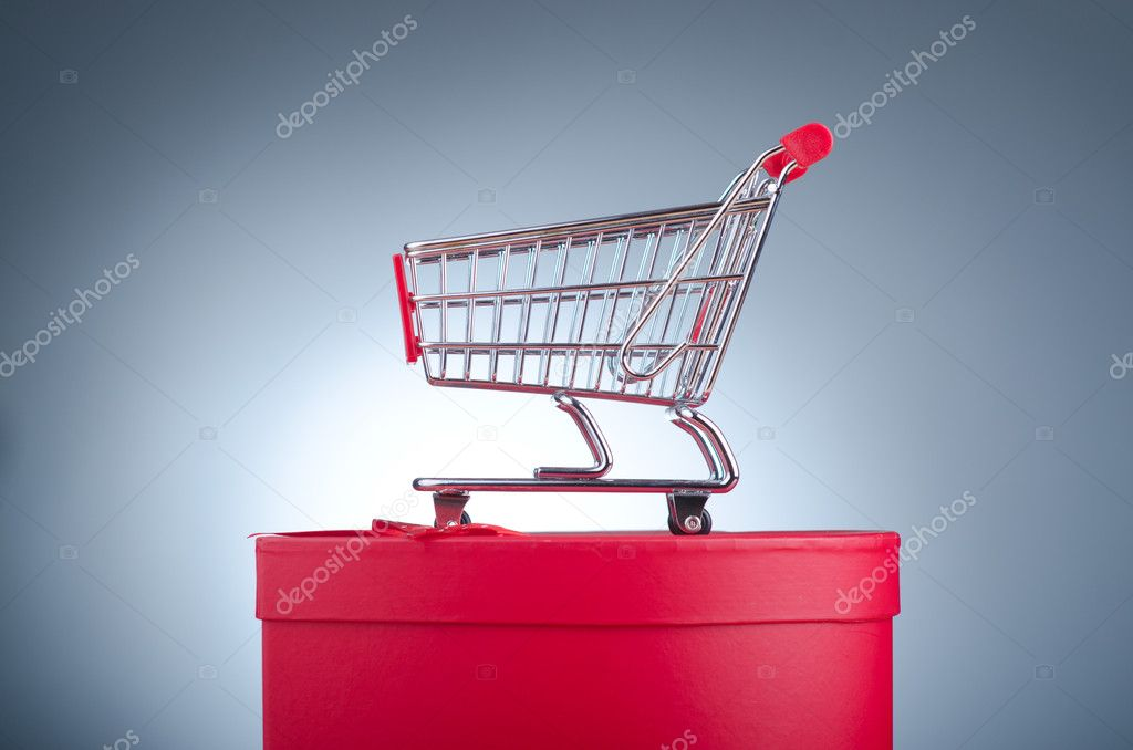 Christmas shopping concept with shopping cart — Stock Photo #8746480