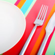 Stock Photo: Empty plate with utensils