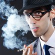Young man smoking cigarette — Stock Photo #8757861