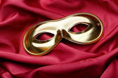 Carnical mask on satin background — Stock Photo