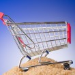 Shopping cart against gradient background — Photo