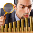 Businessman with golden coins — Stock Photo #8767997