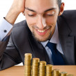 Growth concept with coins and businessman — Stock Photo #8768130