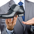 Man with a selection of shoes — Stock Photo #8768896