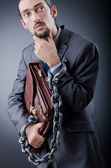 Arrested businessman in studio shooting — Stock Photo
