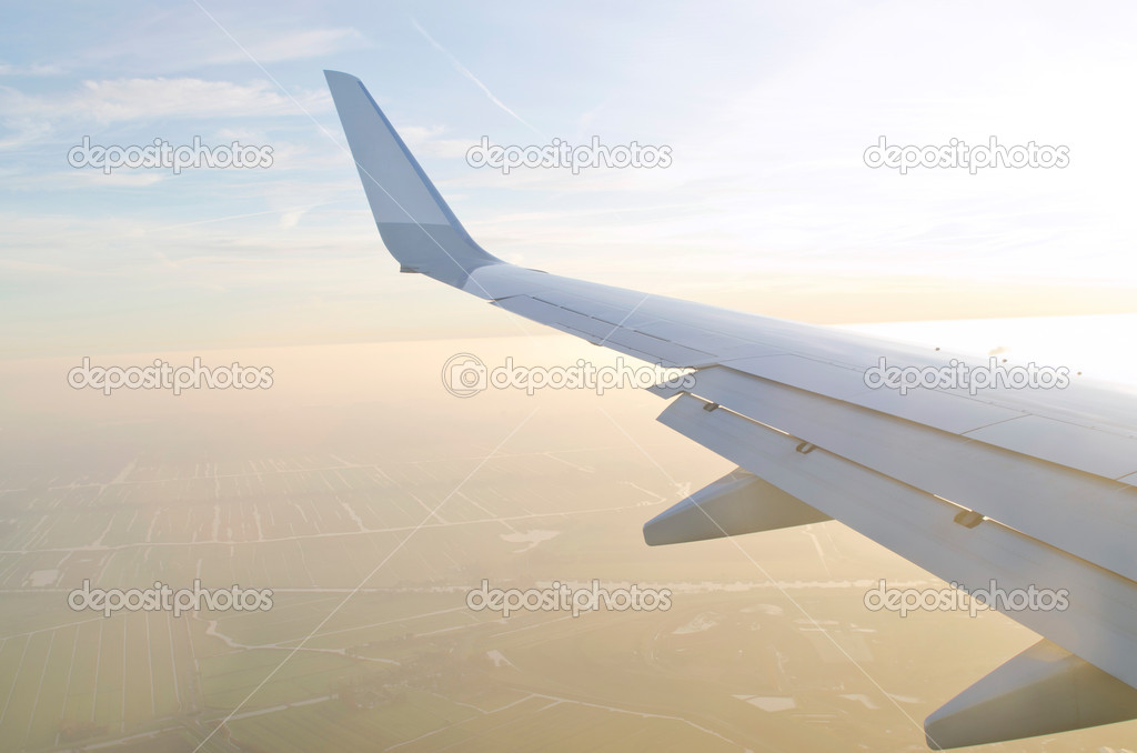 Wing of airplane from window  Stock Photo #8771762