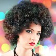 Young attractive girl with afro curly haircut — Stock Photo #8863265