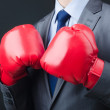 Young businessman with boxing gloves — Stock Photo #8865408