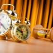 Stock Photo: Time concept with alarm clock and hourglass