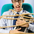 Young businessman tied with rope — Stock Photo #8868432