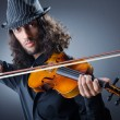 Gypsy violin player in studio - Stock Photo