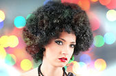 Young attractive girl with afro curly haircut — Stock Photo