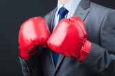 Young businessman with boxing gloves — Stockfoto