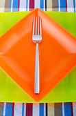 Emtpy plates with utensils on table — Stock Photo