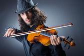 Gypsy violin player in studio — Stock Photo