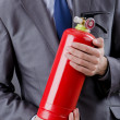 Man with fire extinguisher in firefighting concept — Stock Photo #8870311
