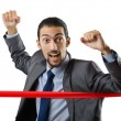 Businessman crossing finish line — Stock Photo #8872841