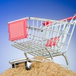 Shopping cart against gradient background — Stock Photo