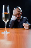 Man suffering from alcohol abuse — Stock Photo