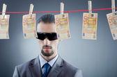 Criminal laundering dirty money — Stock Photo