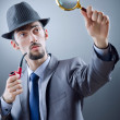 Stock Photo: Detective with smoking pipe