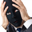 Stock Photo: Industrial espionage concept with masked businessman
