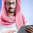 Arab businessman with tablet computer — Stock Photo