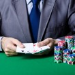 Casino player playing with chips - Stock fotografie