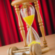 Stock Photo: Hour glass in time concept