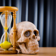 Concept of death with hourglass and skull — Stock Photo #9095580