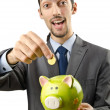 piggybank and man on white — Stock Photo
