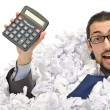 Man with lots of waste paper — Stock Photo