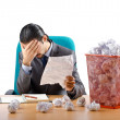 Man with lots of wasted paper — Stock Photo #9097233