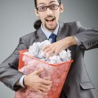 Mwith lots of wasted paper — Stock Photo #9097371