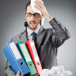 Man with lots of wasted paper — Stock Photo