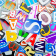 Stock Photo: Newspaper clippings with various letters