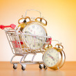 Buying time concept with clock and shopping cart — Stok fotoğraf