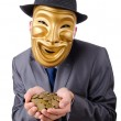 Masked man with coins on white — Stock Photo #9099162