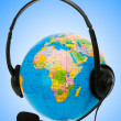Headset on globe isolated on the white — Stock Photo #9099181