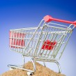 Shopping cart against gradient background — Stok fotoğraf
