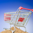 Royalty-Free Stock Photo: Shopping cart against gradient background