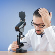 Stock Photo: Chemist working with microscope